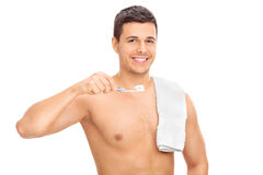 Shirtless man holding a toothbrush Stock Images