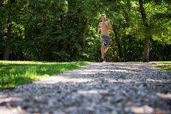 Shirtless Man Jogging Outdoors Stock Images