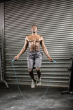 Shirtless man jumping the rope Stock Image