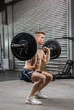 Shirtless man lifting barbell royalty free stock photos