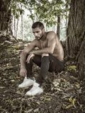 Shirtless man posing in woods Royalty Free Stock Photography