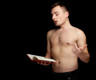 Shirtless man reading book Stock Photos