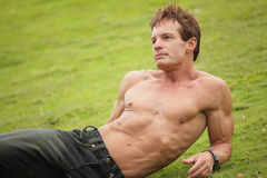 Shirtless man relaxing on the grass Royalty Free Stock Photo
