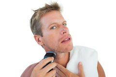 Shirtless man shaving his beard. On white background stock photo