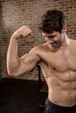 Shirtless man showing his biceps Royalty Free Stock Image
