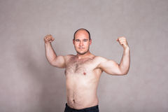 Shirtless man showing his strong arms and body Stock Photos