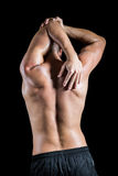 Shirtless man stretching elbow Stock Photos