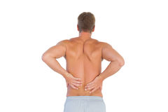Shirtless man suffering from lower back pain Royalty Free Stock Images