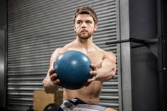 Shirtless man training with medicine ball. At the crossfit gym royalty free stock images