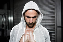 Shirtless man wearing jumper looking down. At the crossfit gym Royalty Free Stock Images