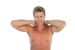 Shirtless man yelling and suffering from neck pain Royalty Free Stock Photos