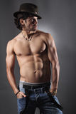 Shirtless model with hat and suspenders Royalty Free Stock Image