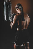 Shirtless muay thai fighter with mongkhon on head stock photography