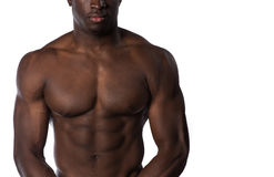 Shirtless muscular African American man. A shirtless portrait of an african american man on an  white background Royalty Free Stock Image