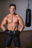 Shirtless muscular boxer shouting in health club Royalty Free Stock Photos