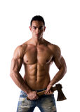 Shirtless muscular male model with axe Stock Photography