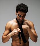 Shirtless muscular man adjusting necktie Royalty Free Stock Photos