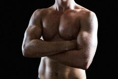 Shirtless muscular man with arms crossed Royalty Free Stock Images