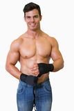 Shirtless muscular man binds bandage on his hand Stock Photos