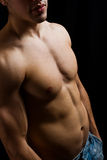 Shirtless muscular man in blue jeans Royalty Free Stock Images