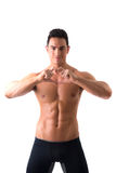 Shirtless muscular man making heart sing with hands Stock Photos