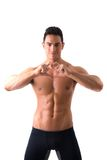 Shirtless muscular man making heart sing with Stock Images