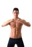 Shirtless muscular man making heart sing with Stock Images