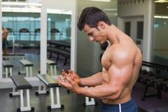 Shirtless muscular man posing in gym Stock Photo