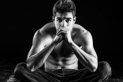 Shirtless muscular man staring into camera seriously Royalty Free Stock Photo