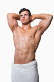 Shirtless muscular man wrapped in white towel Stock Photo