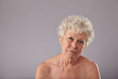 Shirtless old lady looking sad Stock Photo