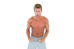 Shirtless serious man showing his muscles Stock Images