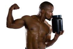 Shirtless sports man kissing supplement jar Stock Images
