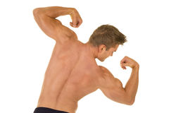 Shirtless strong man flex back tilt look side Royalty Free Stock Photography