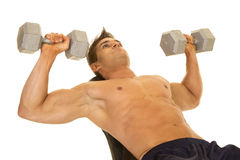 Shirtless strong man lay back dumbell press Stock Image