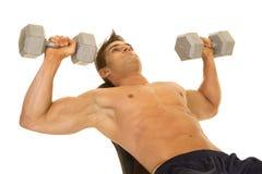 Shirtless strong man lay back dumbell press stock image