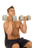 Shirtless strong man press weights Royalty Free Stock Images