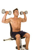 Shirtless strong man sit shoulder press Royalty Free Stock Photography