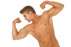 Shirtless strong man tilt and flex look to side Stock Photography