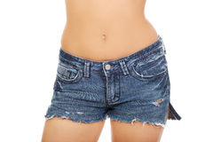 Shirtless woman in jeans shorts. Royalty Free Stock Photos