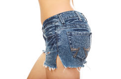 Shirtless woman in jeans shorts. Stock Photo
