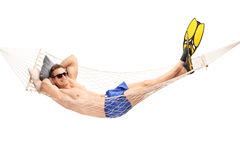 Shirtless young guy lying in a hammock stock image