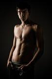 Shirtless young man Stock Image