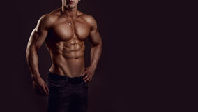 Shirtless young man. Athletic young shirtless muscular man in jeans royalty free stock images