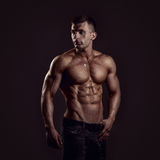 Shirtless young man. Athletic young shirtless muscular man in jeans royalty free stock photos