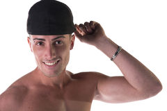 Shirtless young man with black baseball hat Royalty Free Stock Photos