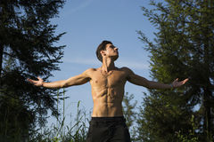 Shirtless young man celebrating nature Stock Image