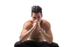 Shirtless young man deep in contemplation Stock Images