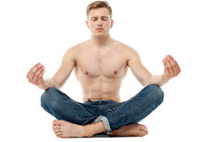 Shirtless young man doing meditation Stock Photography
