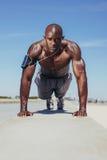 Shirtless young man doing push-ups Stock Images